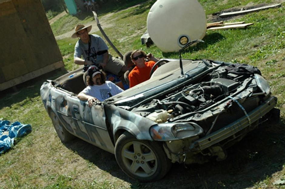 """Brewce Martin in a custom """"derby car"""" shadowed by cameraman Chris Landy"""